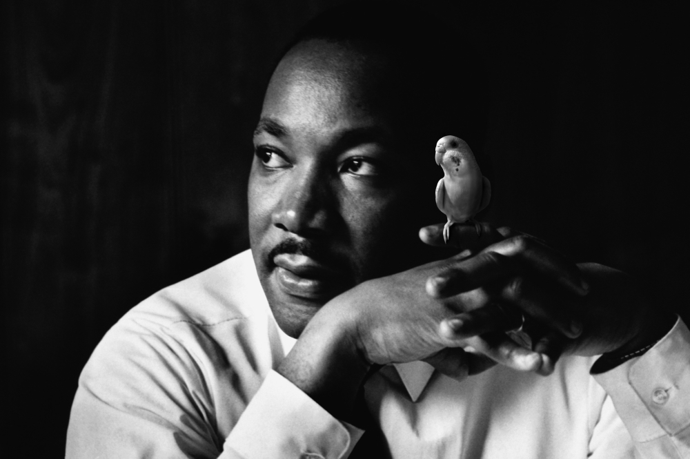 Atlanta, Georgia, USA --- Martin Luther King Jr. listens at a meeting of the SCLC, the Southern Christian Leadership Conference, at a restaurant in Atlanta. The SCLC is a civil rights organization formed by Martin Luther King after the success of the Montgomery bus boycott. --- Image by © Flip Schulke/CORBIS